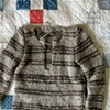 Assembled Sweater