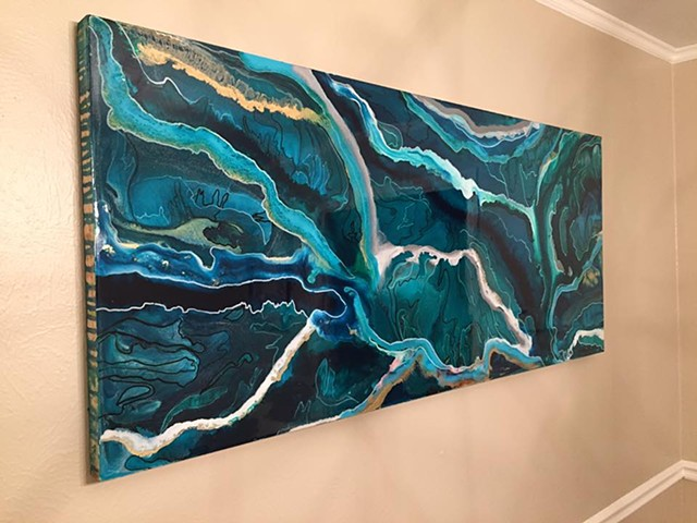 Emerald River is an original, abstract art piece by local fluid artists Suzie Collins.