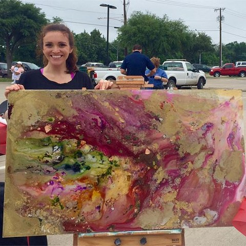 Suzie Collins at a festival with her original, abstract art