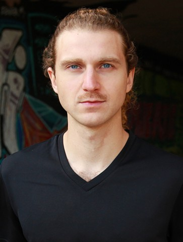 male headshot by Tiger Munson