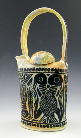 African carving inspired teapot