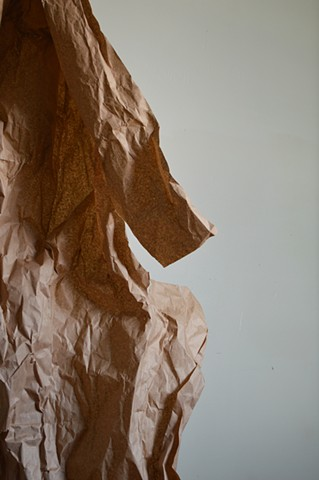 photograph of brown paper wall sculpture art studio by Robyn LeRoy-Evans