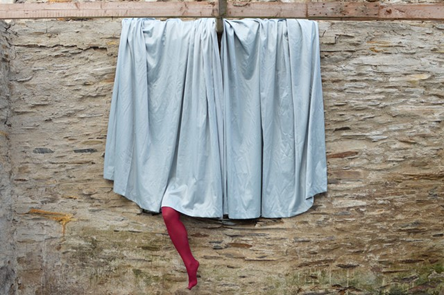 photograph of leg stockings curtains surreal drapery stone building Wales by Robyn LeRoy-Evans