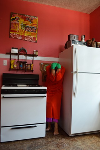 photograph of woman dress kitchen bright colours scared domestic by Robyn LeRoy-Evans