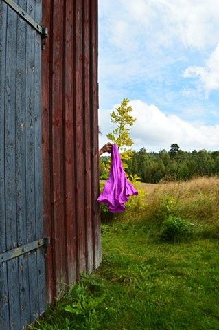 surreal photograph of woman purple fabric farm Sweden by Robyn LeRoy-Evans