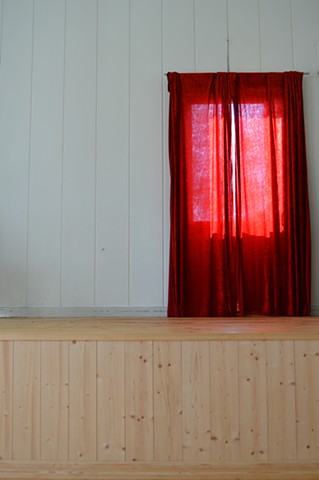 photograph of red curtains white room pine stage by Robyn LeRoy-Evans