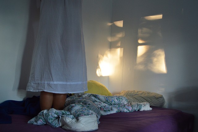surreal photograph of woman bed nightgown by Robyn LeRoy-Evans