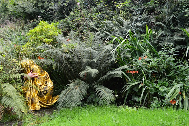 photograph of woman gold drapery green ferns flowers in Wales by Robyn LeRoy-Evans
