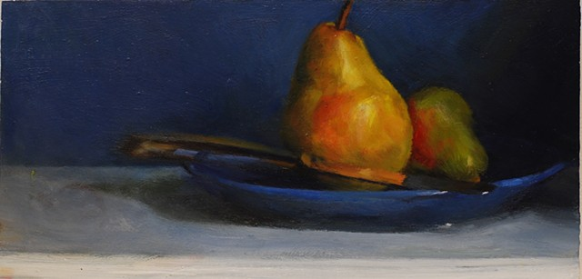 Pears and a blue plate