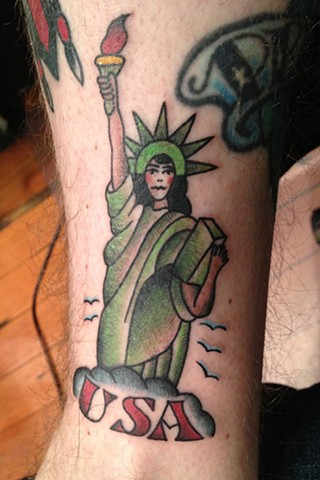 traditional statue of liberty tattoo by Bradley Delay