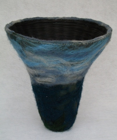 Dyed and woven reed basket with felted wool and silk surface