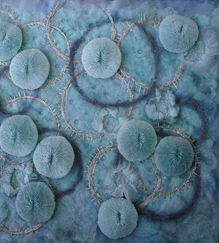 wool and silk embroidered wall hanging with cast resin embellishments
