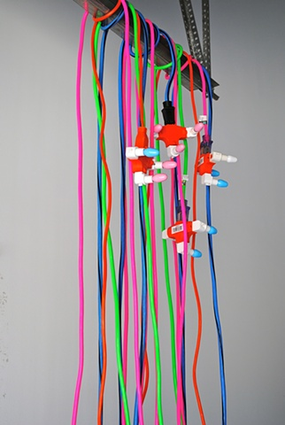 This sculpture is made of electric power cords, adapters, cable ties and light bulbs. New York NY. School of Visual Arts. Skowhegan School of Painting and Sculpture. Mary Carter Taub is an installation artist based in Chapel Hill, NC.