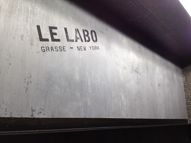 LELABO Faux Concrete Saks Fifth Avenue counter back wall display