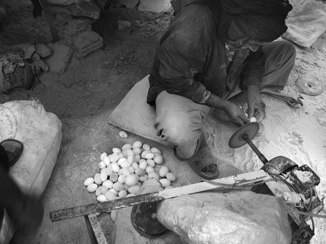 Fossils and rocks are processed in Erfoud for sale in bigger markets. Small trinkets like hand-carved quartz eggs turn profit only with large volumes.