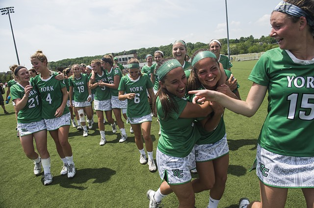 Players for the York College's lacrosse team react after winning the NCAA playoff finals against Gettysburg College.