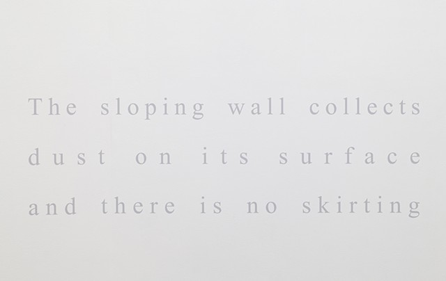 The sloping wall collects dust on its surface and there is no skirting