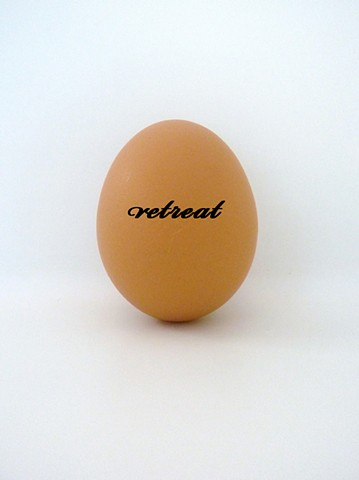 Eggs printed with text, referencing the idea of an egg as a place of retreat and refuge. Sculpture by artist Darren Jones