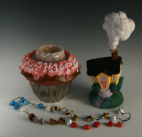Worry beads are housed inside cupcake.