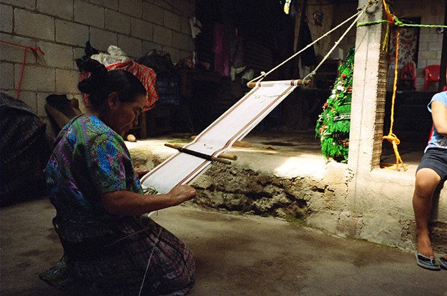 Woman in Santiago Zamora working on new products to sell in their weaving collective store.