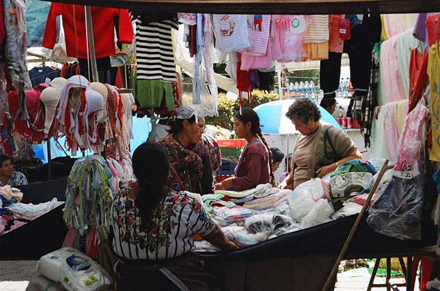 A market stall in Santiago Atitlan, home of prized bird embroidery in the traditional dress.