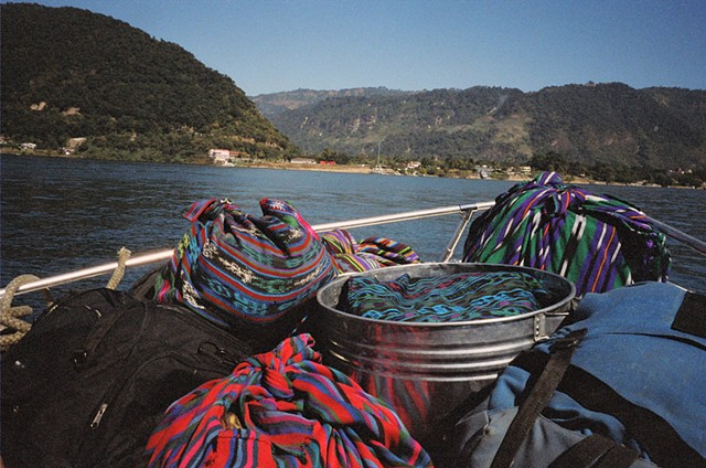 Woven cloth holds together items for transporting across Lago Atitlan, 2010