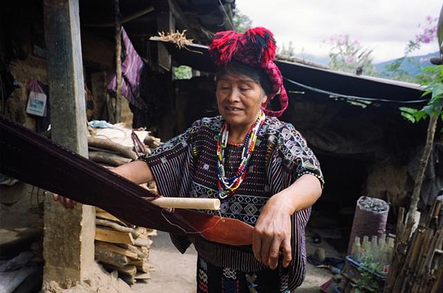A woman in a village outside Colotenango weaving, 2010