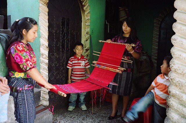 Young women in Chichicastenango show their work-in-progress, 2011