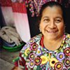 Portrait of a woman working in her Chichicastenango market stall, selling handmade traditional textiles, 2010