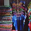 A market stall selling mass produced and trendy huipil for younger generation Maya women