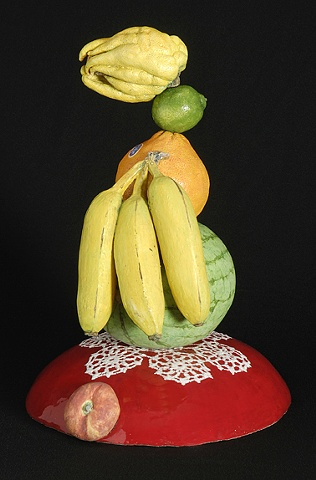 ceramic portrait with buddha's hand, lime, orange, bananas, kumquat, and watermelon by Linda S Fitz Gibbon