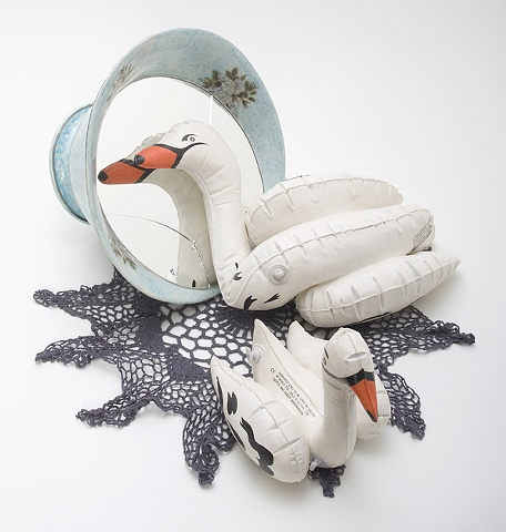Narcissus, large tea cup and inflatable ceramic swans by Linda S Fitz Gibbon