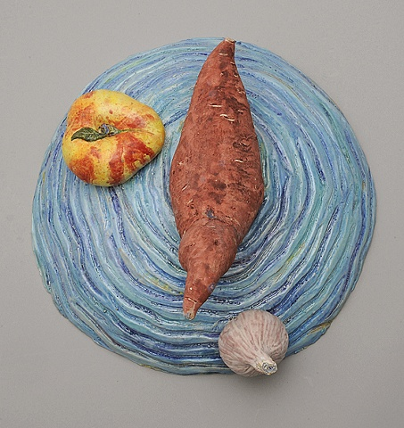 trompe l'oeil ceramic plate with ceramic yam, donut peach, and garlic by Linda S Fitz Gibbon