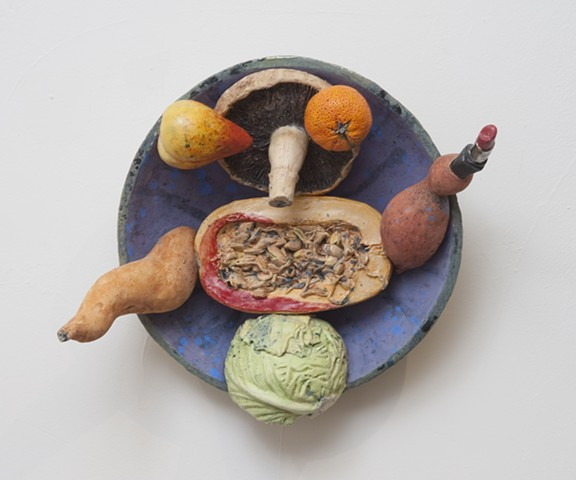 Wall mounted ceramic plate with seasonal produce