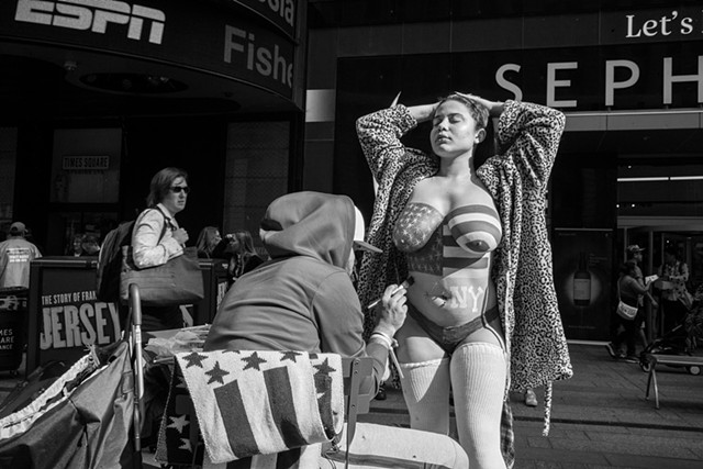 Photograph of a Desnuda being painted in Times Square, NY, Manhattan, by Judith Ebenstein