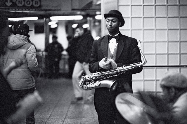 Photograph of a Saxophonist, Times Square Subway, Manhattan, New York, by Judith Ebenstein