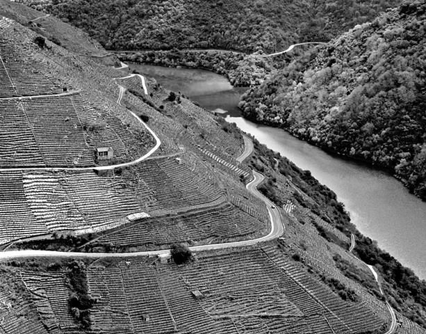 """Ribera Sacra with a View of River Sil-1""  A wine-growing region nestled in the gorge formed by the river Sil in Galicia. What look like horizontal lines on the hill at left are terraces where the vines are grown. See also""Ribeira Sacra Doade""."