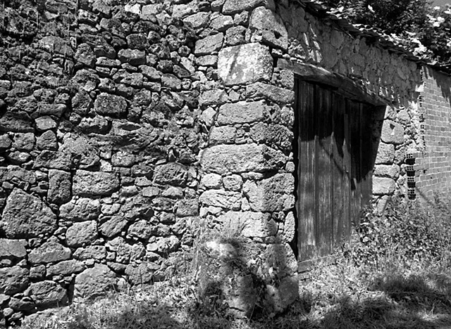 """""""Rock Wall with Wooden Door""""  Remains of an old house in Trasulfe, Spain"""