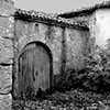 """Closed to the Past""  The house behind the gate used to be a grand residence in the days the village was a thriving one. This is a sad and a common story in Galicia."