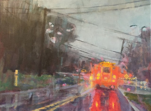 view through rainy car windshield that includes a school bus and oncoming traffic