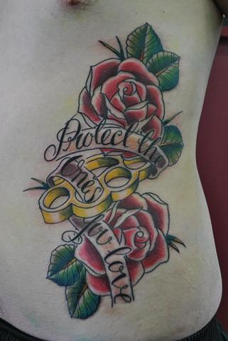 Роза с кастетами тату