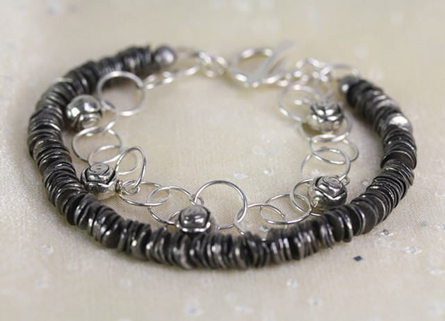 Two-strand German silver, sterling, and fine silver bracelet