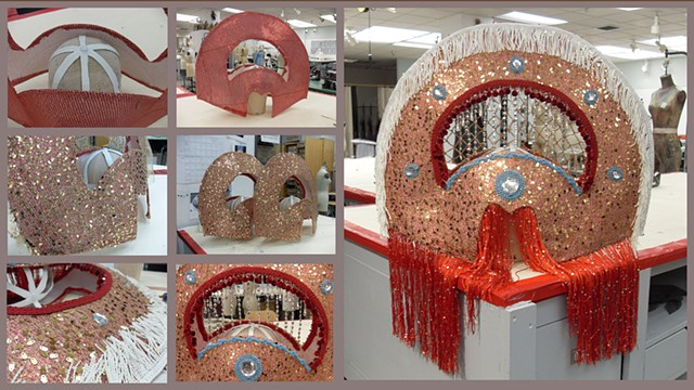 huge buckram headdress with fringe, mirror, and sparkles handmade for a theater production