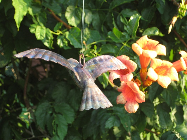 custom hand made hammered copper hummingbird by  tim summerville artist