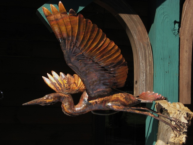 custom hand made hammered copper heron by  tim summerville artist