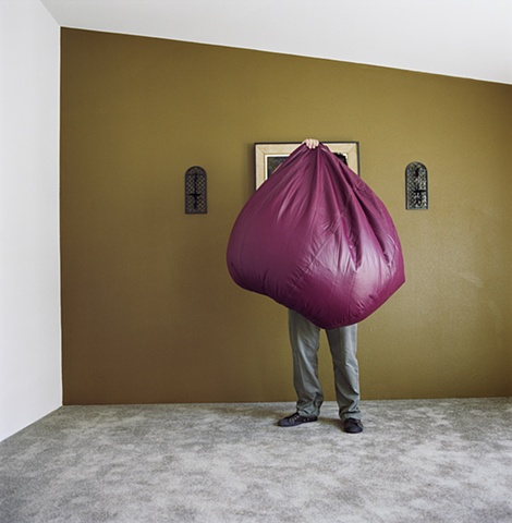 Man holding bean bag, manufactured display home, © Amy Eckert www.amyeckertphoto.com