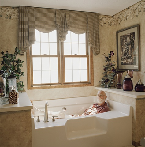 Man in bathtub, manufactured display home, © Amy Eckert www.amyeckertphoto.com