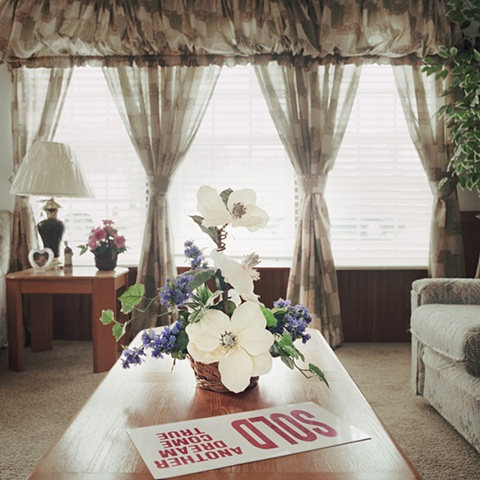 sold sign with plastic flowers, manufactured display home, © Amy Eckert www.amyeckertphoto.com