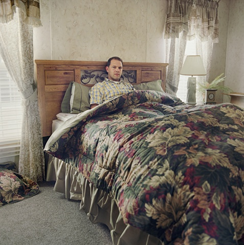 Man in bed, manufactured display home, © Amy Eckert www.amyeckertphoto.com