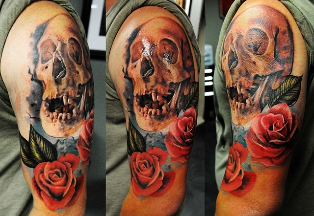 Skull and rose cover up tattoo by Trent Valleau